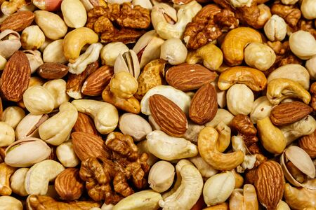Background of mixed nuts (walnuts, pistachio, almond, peanut, cashew, hazelnut). Healthy eating concept 写真素材