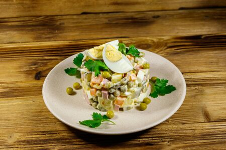 Traditional Russian festive salad Olivier on wooden table 写真素材 - 134956640