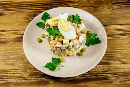 Traditional Russian festive salad Olivier on wooden table 写真素材 - 134956637