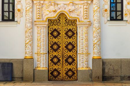Ornamented gilded door of the Dormition cathedral of Kiev Pechersk Lavra (Kiev Monastery of the Caves) in Ukraine