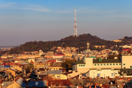 View of High Castle or Castle Hill with TV tower and old town of Lviv in Ukraine. Lvov cityscape. View from bell tower of Church of Sts. Olha and Elizabeth