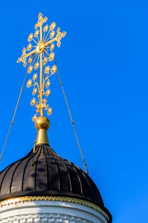 Close-up of golden cross on a dome of orthodox church
