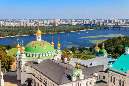 View of the refectory church of Kiev Pechersk Lavra (Kiev Monastery of the Caves) and the Dnieper river in Ukraine. View from Great Lavra Bell Tower