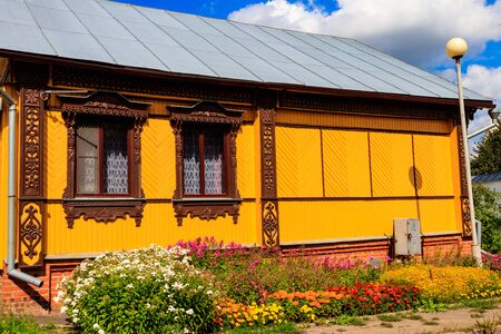 Ornamental windows with carved frames on vintage wooden rural russian house 写真素材