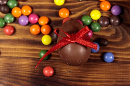 Easter composition with chocolate eggs on wooden background. Top view 写真素材