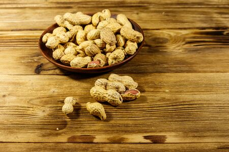 Peanuts in nutshell on a wooden table