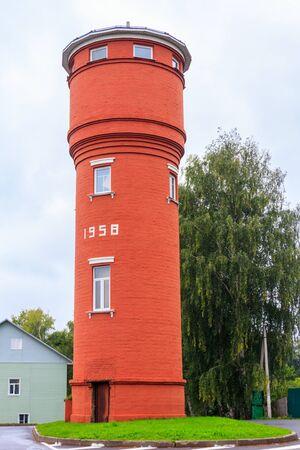 Old red brick water tower in Tolga, suburb of Yaroslavl, Russia