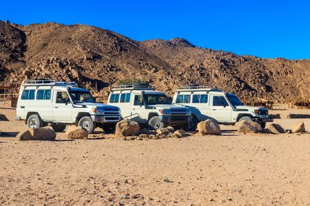Off road SUV cars in bedouin village in Arabian desert near Hurghada, Egypt 写真素材