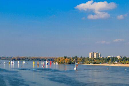 Yachts at sailing regatta on the Dnieper river in Kremenchug, Ukraine