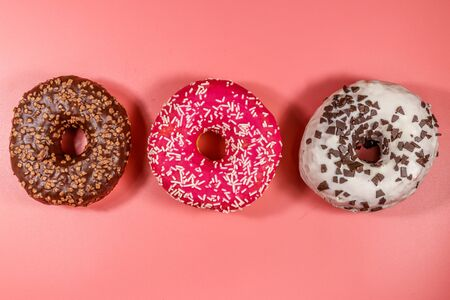 Tasty donuts on pink background. Top view 스톡 콘텐츠