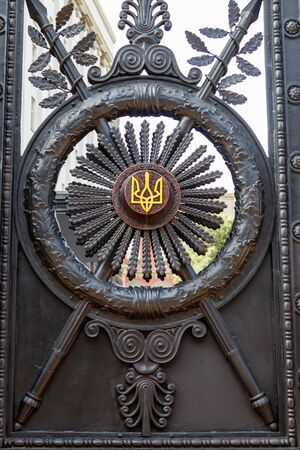 Old massive iron gate with national ukrainian coat of arms trident