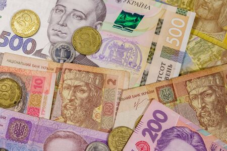 Ukrainian currency. Background of different ukrainian hryvnia banknotes and coins Banco de Imagens