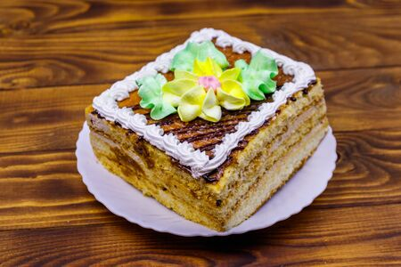 Tasty sweet cake on a wooden table Banco de Imagens