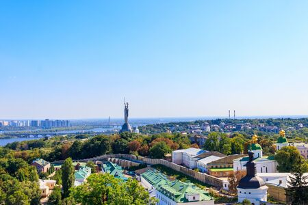 View of Kiev Pechersk Lavra (Kiev Monastery of the Caves), Motherland Monument and the Dnieper river in Ukraine. View from Great Lavra Bell Tower