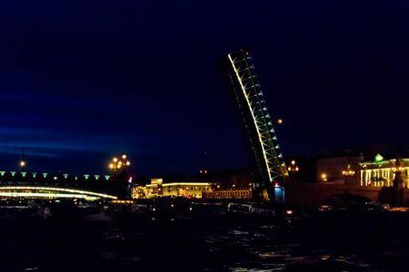 Opening of Trinity drawbridge. Night view of Trinity bridge from the Neva river in St. Petersburg, Russia