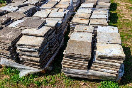 Stacks of paving slabs at construction site