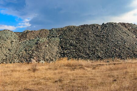 View of slag heaps of iron ore quarry. Mining industry Reklamní fotografie