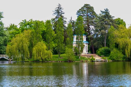 View of Upper Pond and Pink Pavilion on island of Anti-Circe (island of love) in Sofiyivka park in Uman, Ukraine