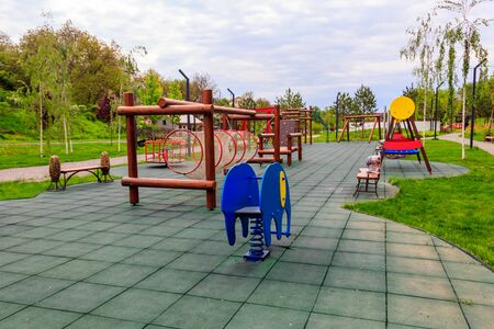 Empty colorful children's playground in a city park Stockfoto
