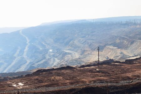 View of the iron ore quarry in morning haze