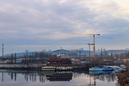 View of the Dnieper river and construction cranes on right bank in Kiev, Ukraine 版權商用圖片