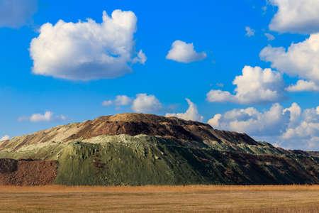 View of slag heaps of iron ore quarry. Mining industry Standard-Bild