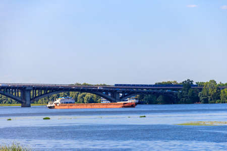 Heavy long barge sailing on the Dnieper river in Kiev, Ukraine