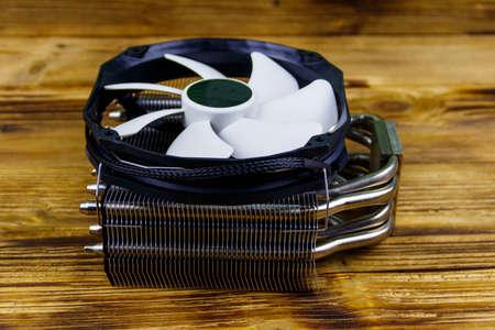 Modern CPU cooler on a wooden desk 写真素材 - 152419120