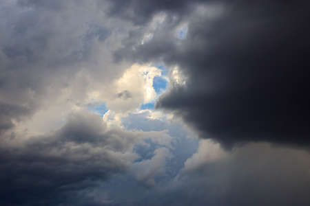 Dark storm clouds in sky before thunderstorm and rain. Dramatic sky background