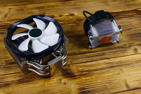 Two modern CPU coolers on a wooden desk 写真素材 - 152418897