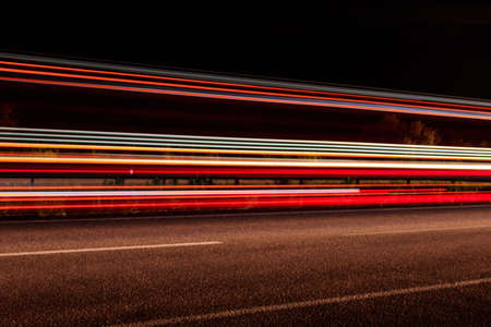 Traffic light trails on a highway at night