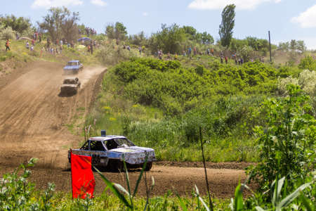 Alexandria, Ukraine - June 10, 2017: Race of the old wrecked cars. Racing in the open air with dust