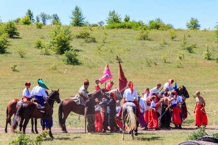 Dnepropetrovsk region, Ukraine - June 2, 2018: Ethno-rock festival Kozak Fest. Reenactment of Battle of Zhovti Vody between cossacks in alliance with Crimean tatars and Polish forces