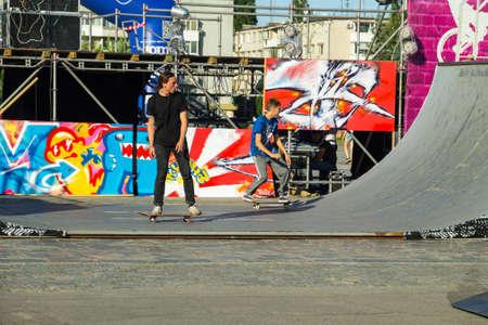 Kremenchug, Ukraine - June 5, 2017: Skateboarder doing a trick in a skate park on youth festival Extreme zone