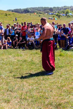 Dnipropetrovsk region, Ukraine - June 2, 2018: Ukrainian Cossack performs with sabers during ethno-rock festival Kozak Fest 報道画像