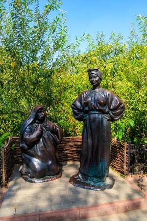 Myrhorod, Ukraine - August 26, 2018: Sculpture of characters of russian writer Nikolai Gogol in Myrhorod, Ukraine
