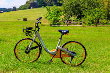 Modern bicycle parked on a green lawn in rural area Reklamní fotografie