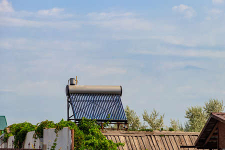 Solar water heater on a residential house rooftop. Renewable energy for house