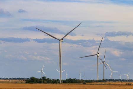 Wind turbines in a field. Renewable energy