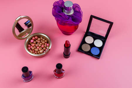 Set of decorative cosmetics on a pink background. Flat lay