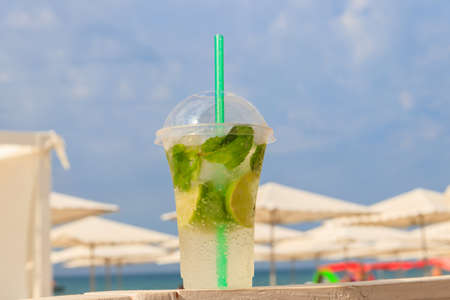Fresh mojito cocktail on a table on a background of tropical beach 写真素材