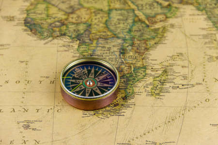 Compass on a vintage world map. Retro style
