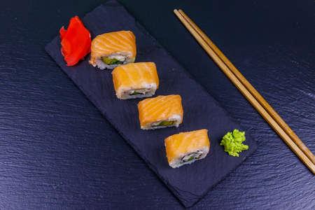 Sushi rolls Philadelphia on a black slate. Top view 스톡 콘텐츠