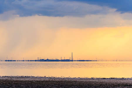 View of a factory on a shore of lake at sunset 写真素材 - 157824282