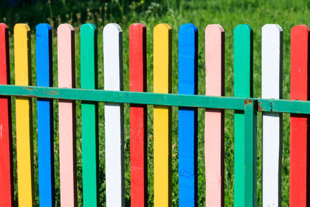 Close-up of the multicolored painted wooden fence