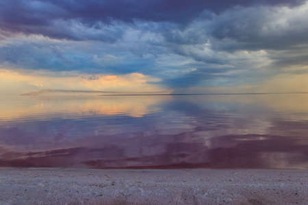 Dark storm clouds over a salt lake before a rain 免版税图像
