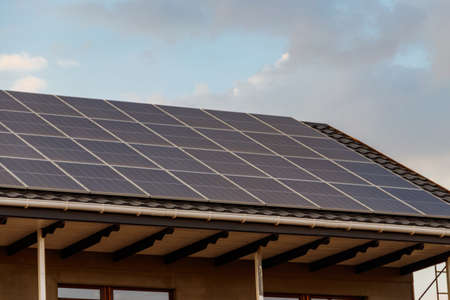 Solar panels on a roof of residential house. Photovoltaic modules for innovation alternative energy
