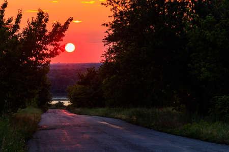 Beautiful sunset over a rural asphalt road