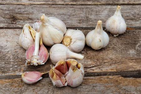 Fresh garlic on a rustic wooden table