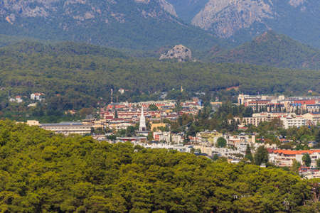 View of Kemer town on a coast of the Mediterranean sea in Antalya province, Turkey. Turkish Riviera. View from a mountain